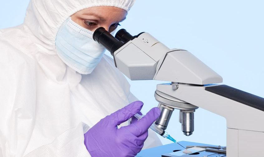 embryologist examining a sperm sample