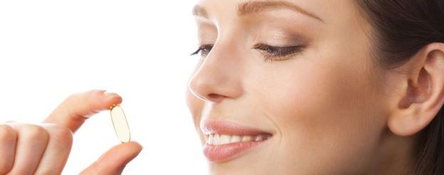 woman holding vitamin