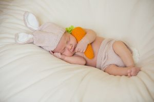 Sleeping baby with a crochet toy