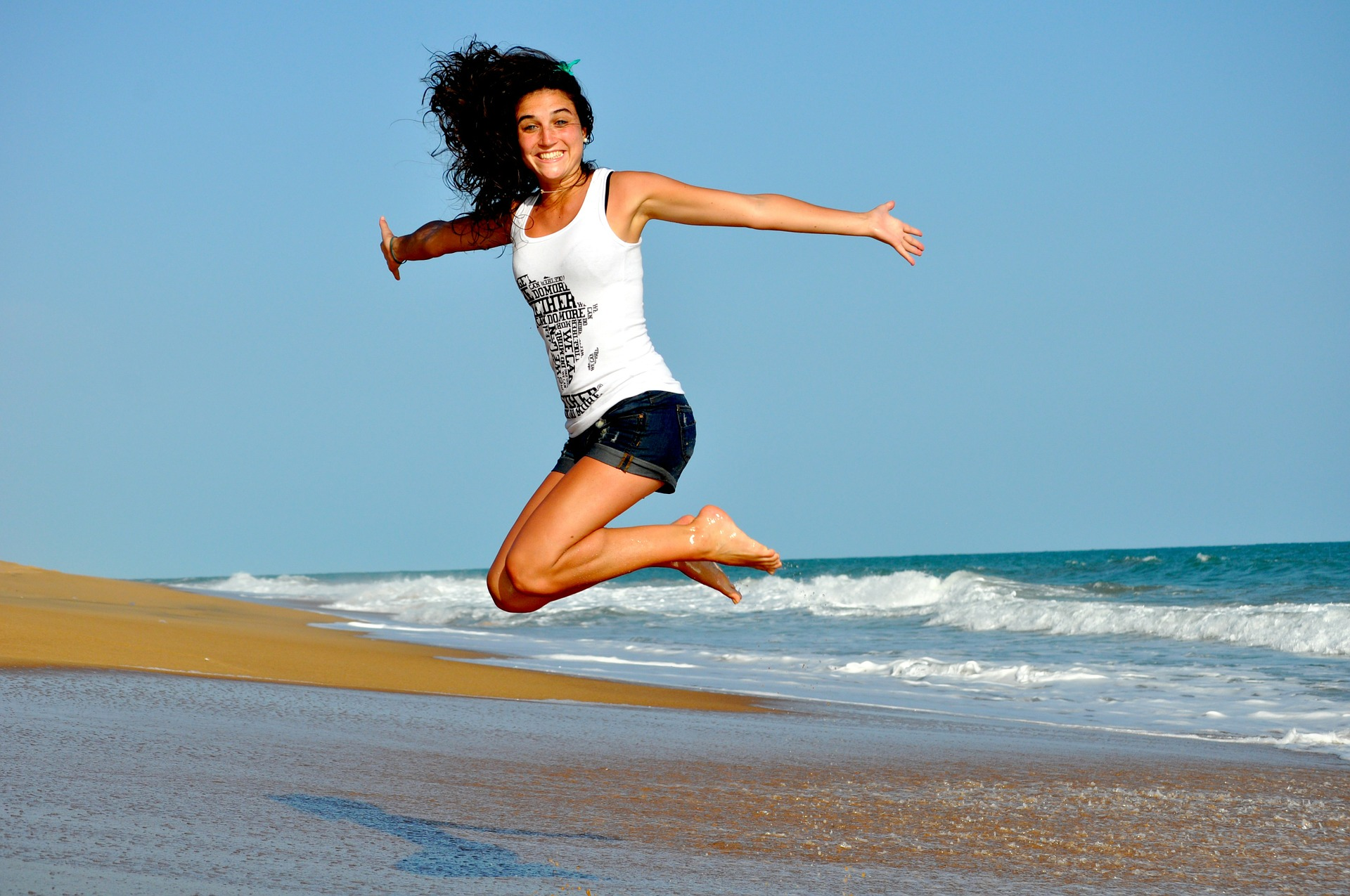 How can I improve my chances of falling pregnant? A healthy woman jumping on the sand